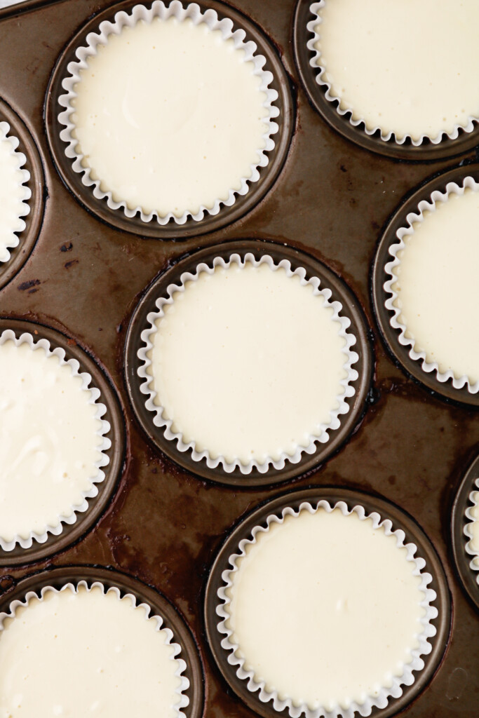 Pour cheesecake batter in muffin liners