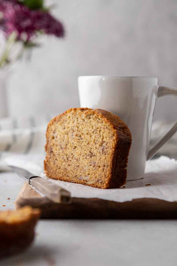 Quick bread slice next to coffee cup