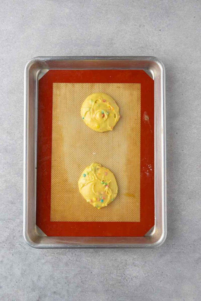 Raw cookie dough on baking sheet