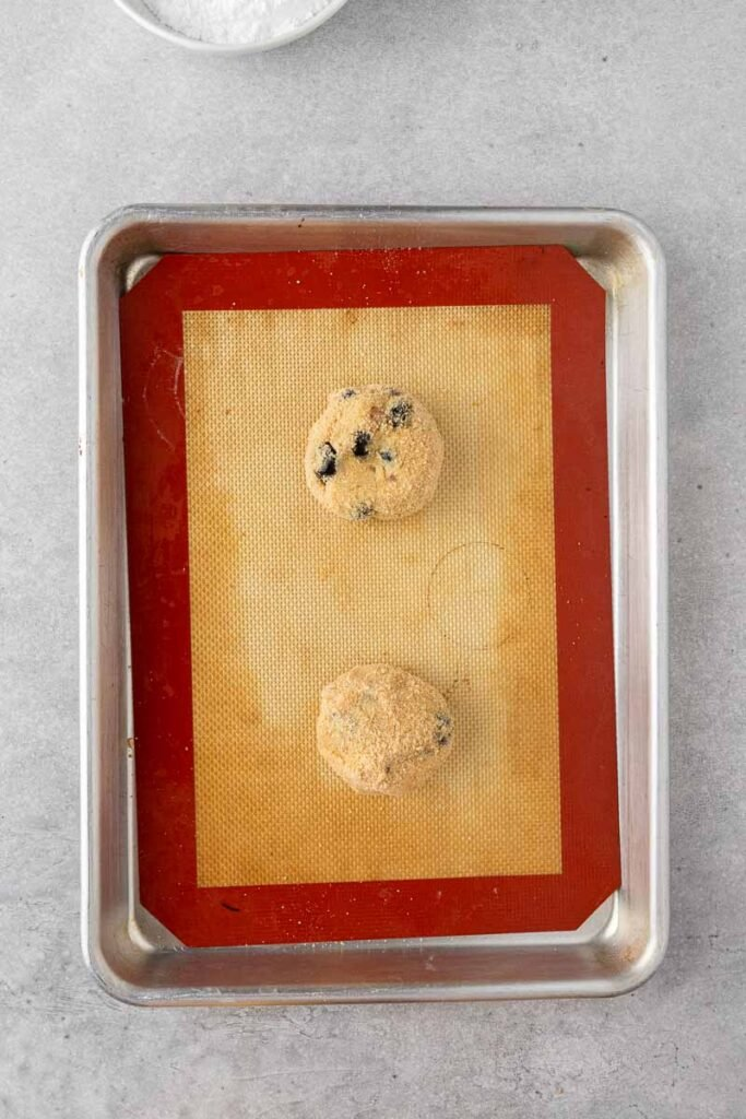 Blueberry cookie dough on a baking sheet