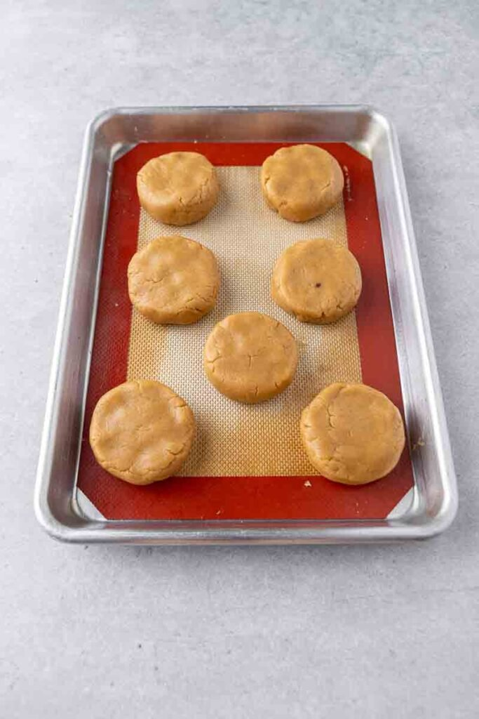 Thick peanut butter cookie dough on baking sheet