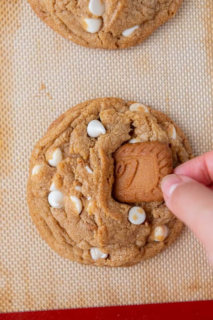 Placing a Biscoff cookie on top of the cookie butter cookie