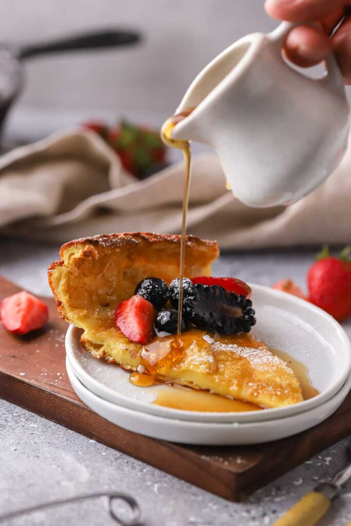 Slice of german pancake topped with berries
