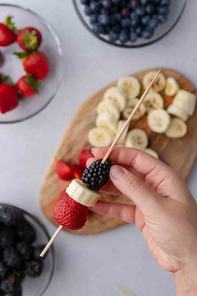 strawberry, banana, and blackberry on a skewer