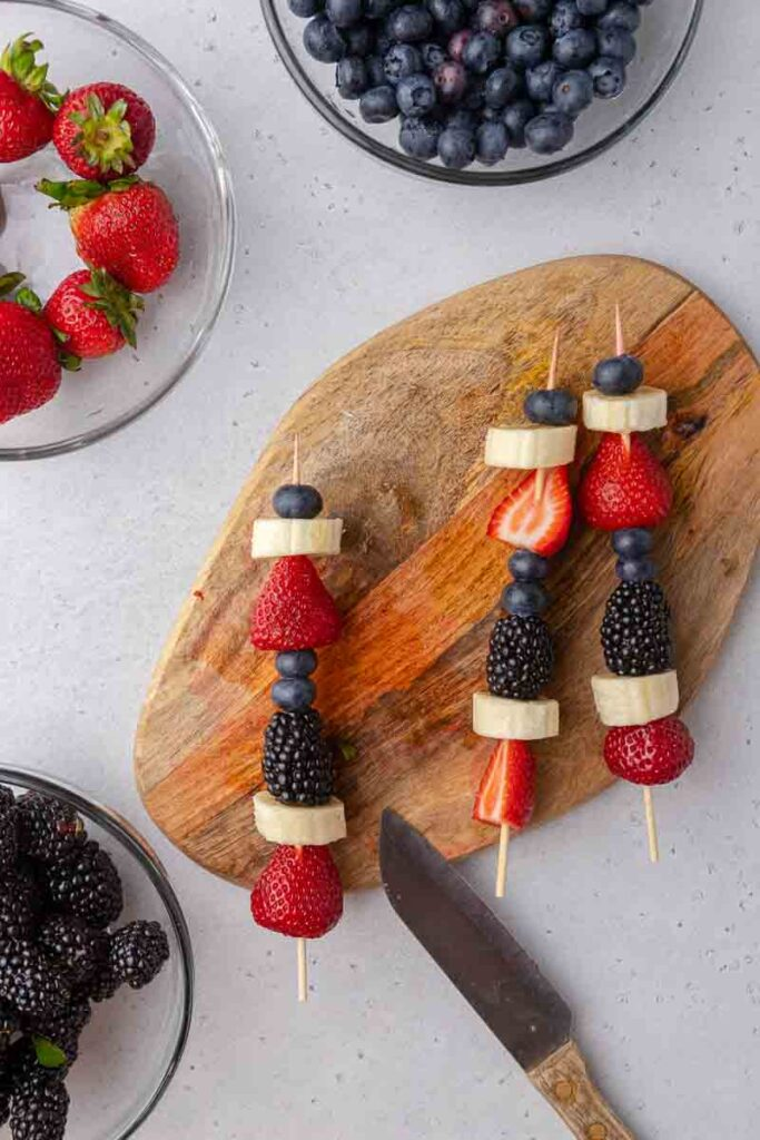 4th of july fruit skewers on cutting board