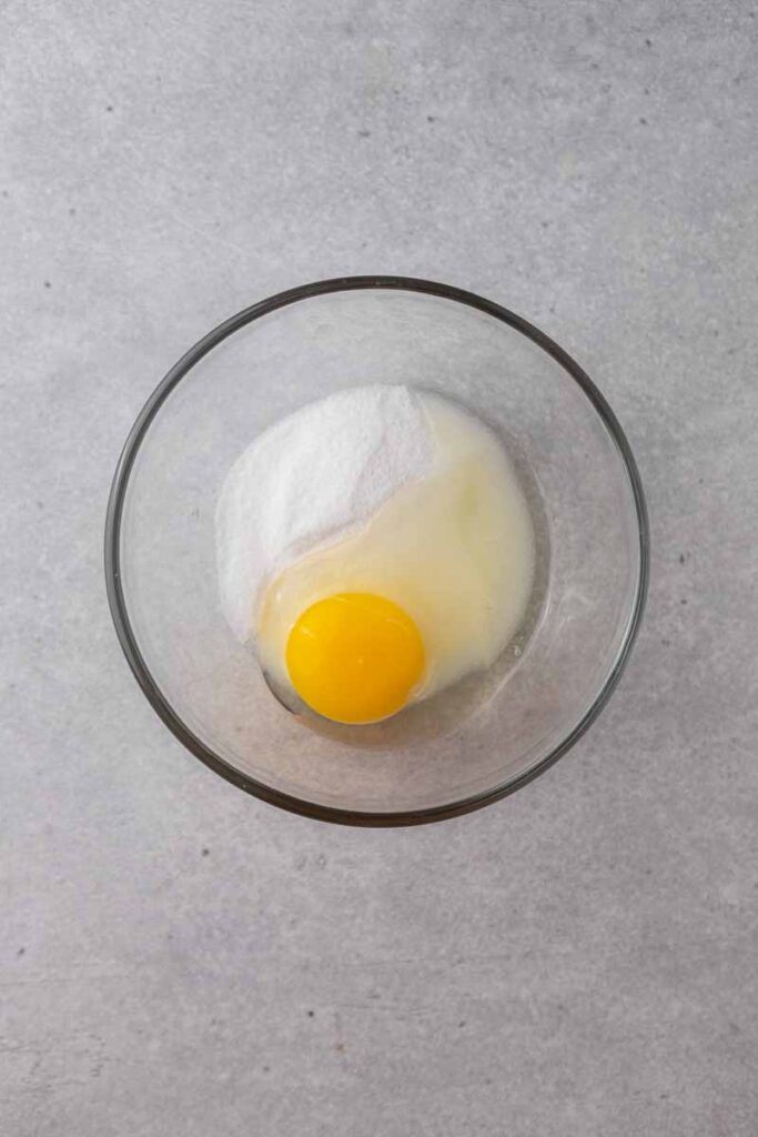 Egg and sugar in mixing bowl