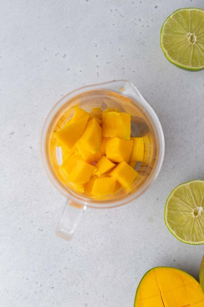 Mango chunks in a blender cup