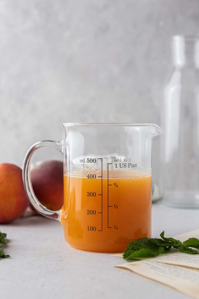 peach syrup in a glass