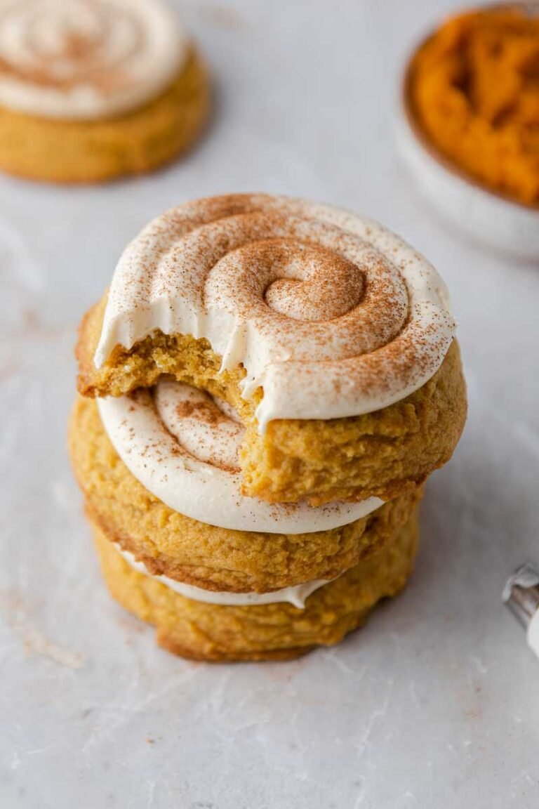 Stacked frosted pumpkin cookies