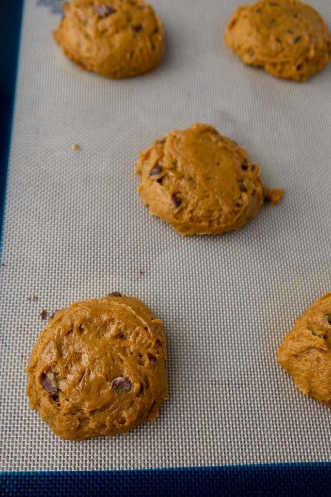 Pumpkin chocolate chip cookie dough on baking sheet