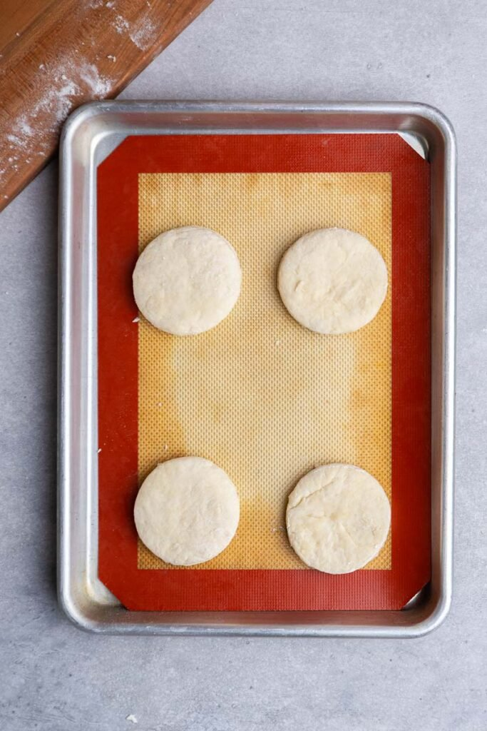 Raw biscuits on baking sheet