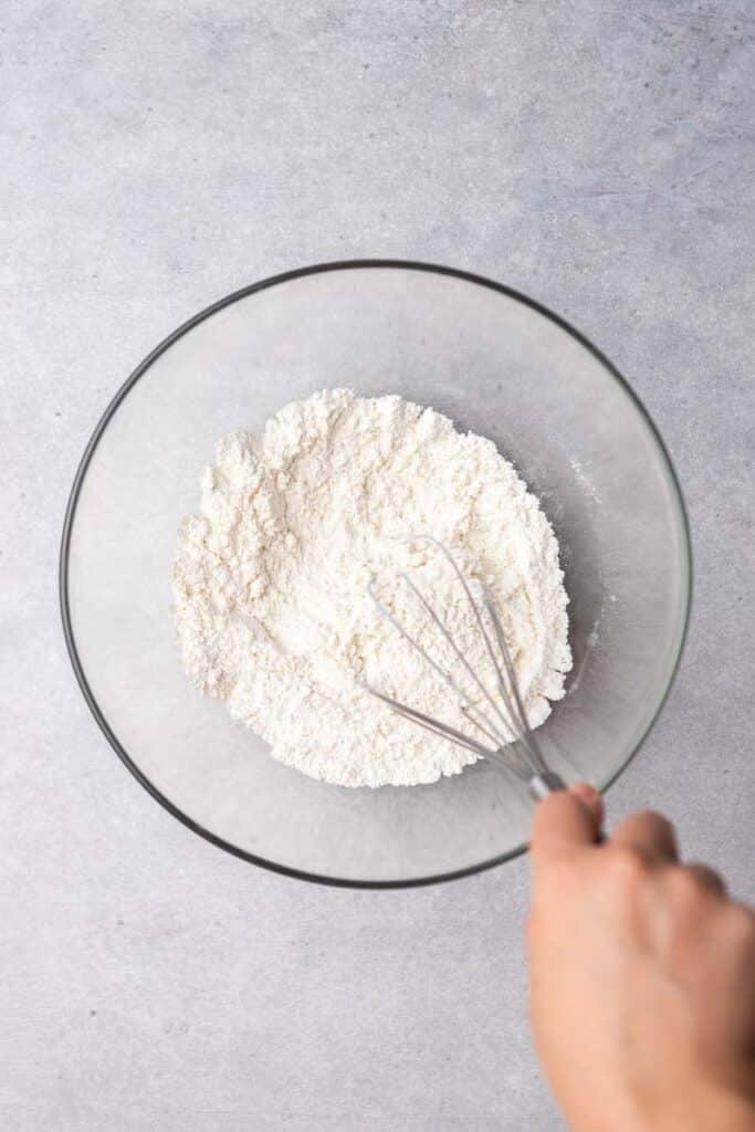hand whisking dry ingredients