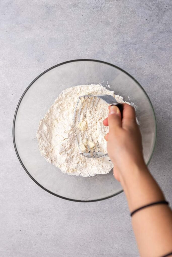 Hand using a pastry cutter