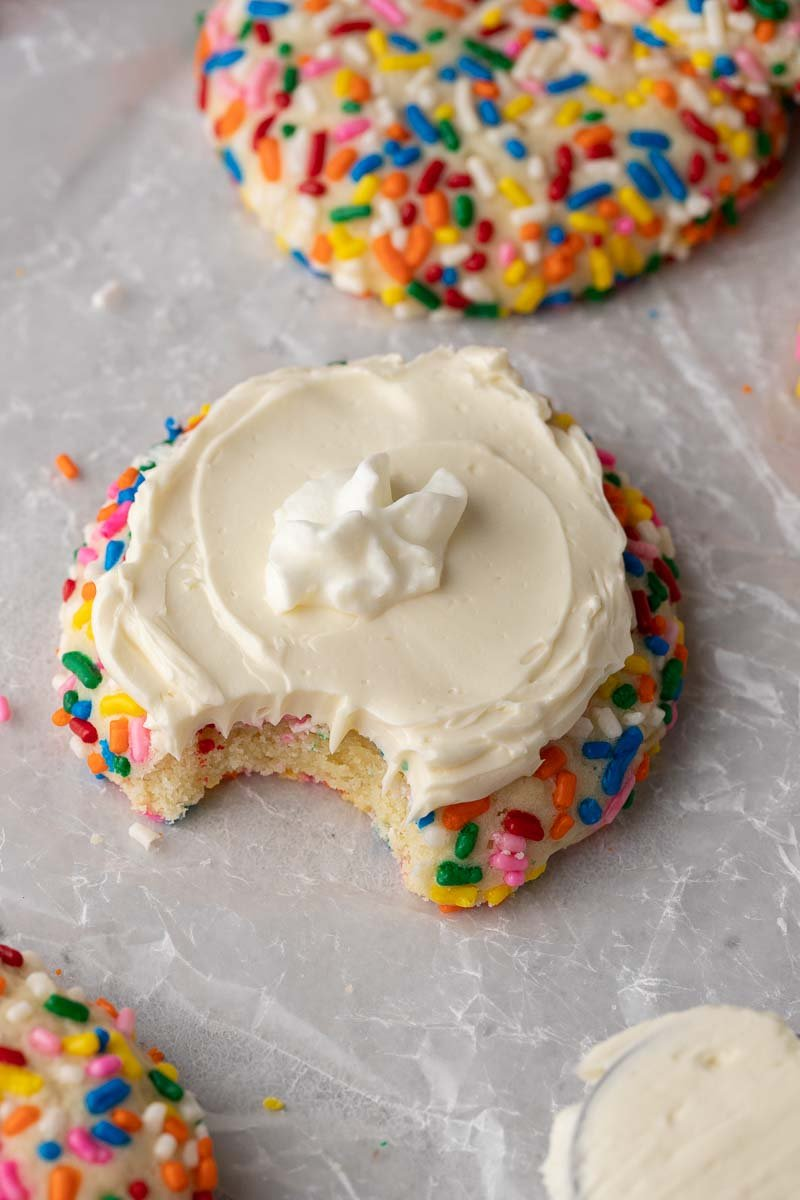 Crumbl funfetti milkshake cookie with a bite taken out of it